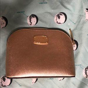 Gold Michael Kors makeup bag